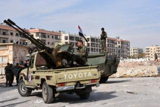Syrian government troops in the recaptured village of al-Minian, Aleppo, 12 November