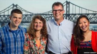 Photo of the Garratt family in front of the bridge linking China and North Korea