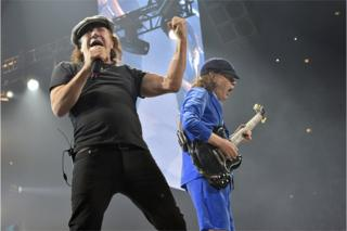 In this 17 February 2016 file photo, Brian Johnson, left, and Angus Young perform with AC/DC on the Rock or Bust Tour in Chicago.