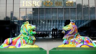 A photo of the two rainbow coloured lions outside the HSBC main building in Hong Kong