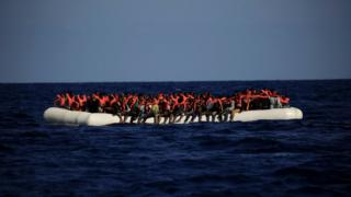 An overcrowded dinghy with migrants from different African countries is pictured off the Libyan coast in the Mediterranean Sea on 21 September 2016
