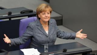 German Chancellor Angela Merkel speaks during a special meeting at the Bundestag in Berlin, Germany, 19 August 2015