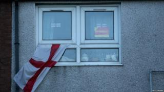 A poster supporting Labour candidate Jim McMahon in a window in Oldham