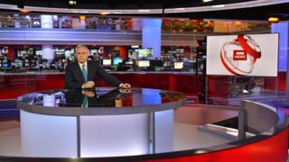 Huw Edwards in the BBC newsroom studio