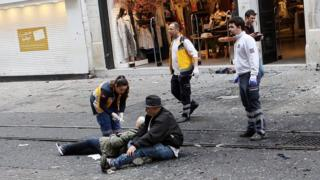 Medics try to help wounded people after the 19 March bombing in Istanbul. Following the attacks in Brussels, some social media users claimed recent attacks in Turkey and elsewhere had been downplayed compared to similar attacks in Europe and the West