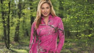 A model wearing blaze pink