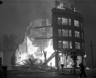 Burning building in Manchester after a German air raid, December 1940