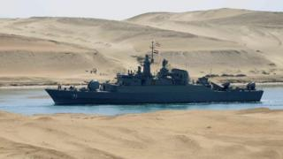 In this file photo of 2011, the Iranian navy frigate IS Alvand passes through the Suez Canal at Ismailia, Egypt.