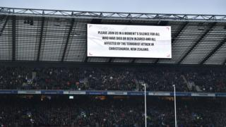 A large sign explaining a minutes silence will be held in respect of those who died in the Christchurch terror attack.