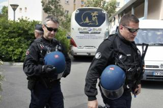 French police pass a Russian fan bus in Mandelieu near Cannes, 14 June