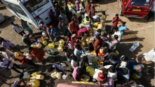 Farmers from the different drought affected districts of Maharashtra collects water from the water tank near a temporary refugee camp in Mumbai, India,