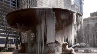 Josephine Shaw Lowell Memorial Fountain in Bryant Park, New York City, is covered in ice. 13 March 2017