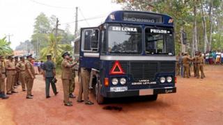 Sri Lankan police officers inspect a prison bus after gunmen opened fire in Colombo, Sri Lanka February 27, 2017.