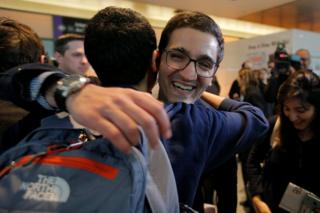 Behnam Partopour, a Worcester Polytechnic Institute (WPI) student from Iran, is greeted by friends at Logan Airport after he cleared U.S. customs and immigration on an F1 student visa in Boston, Massachusetts, 3 February