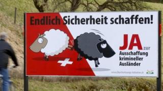 Posters of Swiss People's Party (SVP) demanding to deport criminal foreigners are displayed beside a road in Adliswil, Switzerland, on 11 February 2016