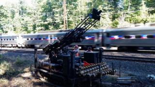 Train goes past search site