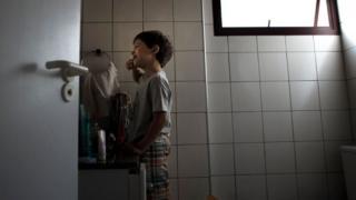 Joao, brushing his teeth