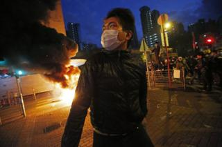 Smoke rises as protestors set fires on a street in Mong Kok district of Hong Kong, Tuesday, 9 February 2016.