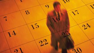 Man walks across calendar