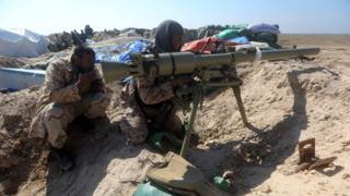 Iraqi Shia fighters from the Popular Mobilisation units, monitor the frontline near Tharthar lake, north of Falluja, 11 February