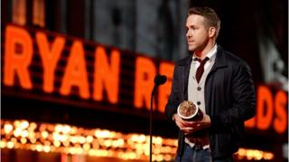 Ryan Reynolds accepts an award for his role in Deadpool