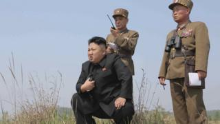 North Korean leader Kim Jong-un inspects military drill. Undated image from KCNA