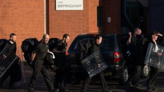 Prison officers with riot shields at Birmingham Prison