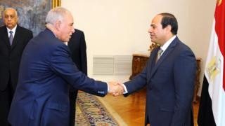"A file handout picture made available by the Egyptian presidency on May 20, 2015 shows Egyptian President Abdel Fattah al-Sisi (R) shaking hands with Egypt""s Justice Minister Ahmed al-Zind"