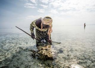 Mama Juma fishing