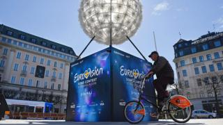 A man cycles past the Eurovision Song Contest countdown clock in Stockholm, Sweden, on 2 May 2016,