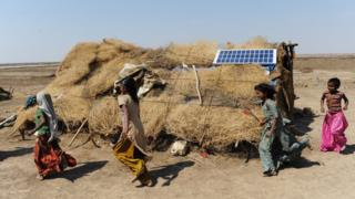 Indian villagers at a solar farm