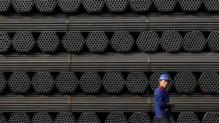 A worker at a steel pipe plant in Tangshan, China
