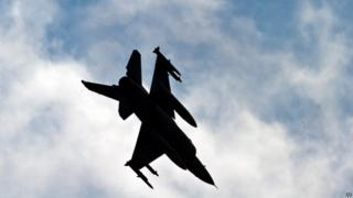 A Turkish Air Force fighter jet makes a landing approach at Incirlik Air Base, Turkey, Friday, Aug. 30, 2013.