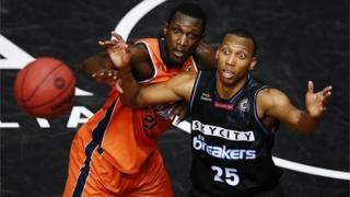 JANUARY 26: Akil Mitchell of the Breakers looks to catch a pass against Nnanna Egwu of the Taipans during the round 17 NBL match between the New Zealand Breakers and the Cairns Taipans at the North Shore Events Centre on January 26, 2017 in Auckland, New Zealand.