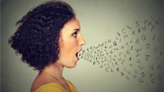 Women with letters coming out of her mouth