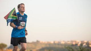 """Comic Relief handout file photo of Eddie Izzard during marathon number ten of 27 in his gruelling Sport Relief challenge. The finish line is in sight as he prepares to reach Robben Island on the final leg of his challenge, that pays tribute to Nelson Mandela""""s life."""