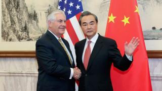 China's Foreign Minister Wang Yi (R) and US Secretary of State Rex Tillerson at the Diaoyutai State Guesthouse in Beijing, on 18 March2017