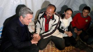 UN refugee agency chief Filippo Grandi (left) meeting Syrian refugees in the Bekaa Valley, Lebanon, 22 January