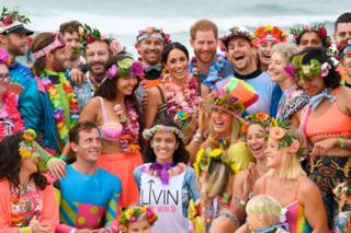 Meghan and Harry with OneWave, a local surfing community group
