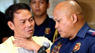 Mayor Ronaldo Espinosa (L) who was shot dead by Philippines police in his jail cell, 5 November, 2016