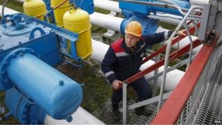 A worker checks equipment at the Dashava gas storage near the western Ukrainian town Stryi