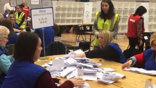 Polling staff begin counting at the Foyle Arena in Londonderry