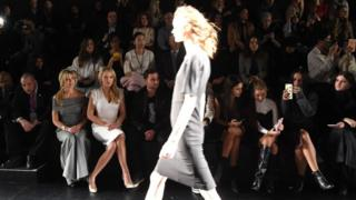A model walks in front of the audience at a Taoray Wang show. Left-right: Marla Maples, Tiffany Trump, Ross Mechanic and others. February 11, 2017 in New York City, USA.