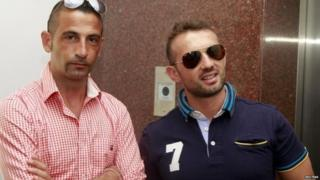 File pic of Massimiliano Latorre (L) and Salvatore Girone (Dec 2012)