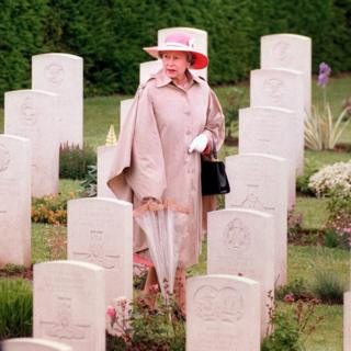 Queen walking through the gravestones at Bayeux Cemetery after a D-Day Commemoration service