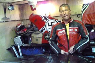 Hitman Nadim Ayupov with the motorbike plastered with Nazi symbols