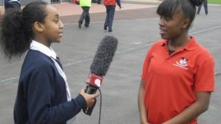 A School Reporter does an interview