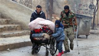 Syrian civilians leave towards safer rebel-held areas in Aleppo, on December 13, 2016,