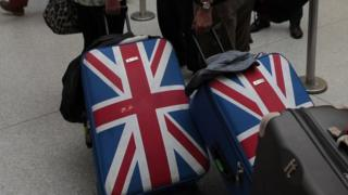 Suitcases flashy with a UK flag