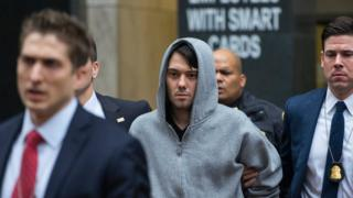 Martin Shkreli, the former hedge fund manager under fire for buying a pharmaceutical company and ratcheting up the price of a life-saving drug, is escorted by law enforcement agents in New York
